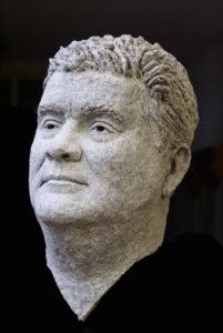 mannen portret in brons